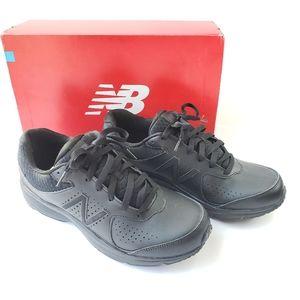 NIB New Balance black walking shoes 411